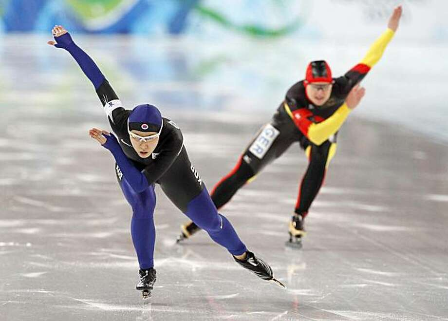 Gold medallist Korea's Lee Sang-Hwa, left, and silver medallist Germany's Jenny Wolf, right, skate during the second of two heats of the women's 500 meter race at the Richmond Olympic Oval at the Vancouver 2010 Olympics in Vancouver, British Columbia, Tuesday, Feb. 16, 2010. Photo: Chris Carlson, AP