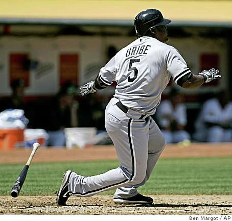 Chicago White Sox' Juan Uribe swings for an RBI double off Oakland Athletics' Greg Smith during the second inning of a baseball game Saturday, Aug. 16, 2008, in Oakland, Calif. (AP Photo/Ben Margot) Photo: Ben Margot, AP