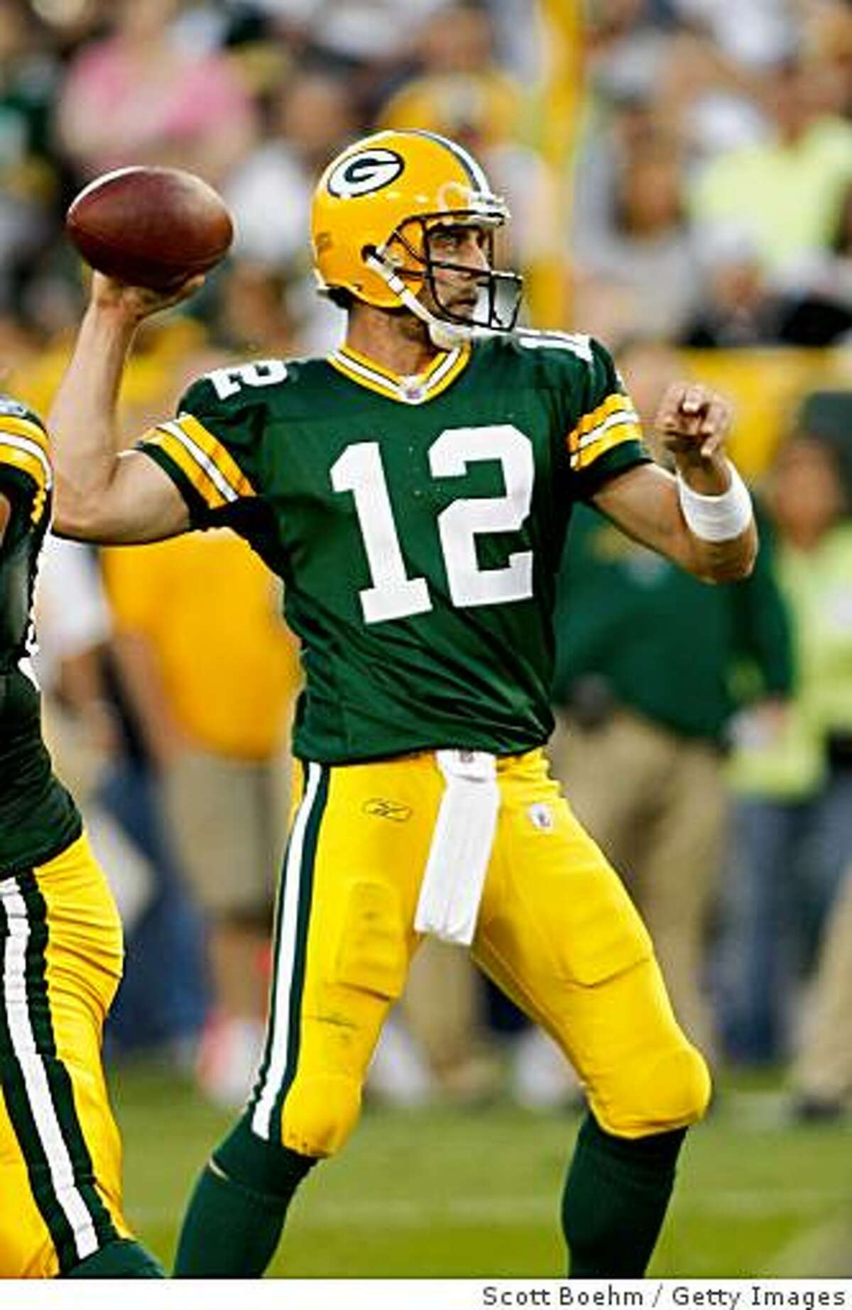 GREEN BAY, WI - AUGUST 11: Quarterback Aaron Rogers #12 of the Green Bay Packers passes the football against the Cincinnati Bengals at the Lambeau Field on August 11, 2008 in Green Bay, Wisconsin. The Bengals defeated the Packers 20-17. (Photo by Scott Boehm/Getty Images)