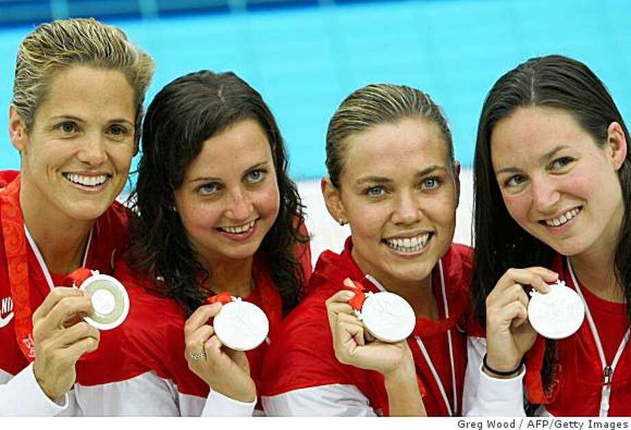 Dara Torres (L), Natalie Coughlin (2nd R) Rebecca Soni (2nd L) and Christine Magnuson pose with their silver medals after the women's 4 x 100m medley relay swimming final medal ceremony at the National Aquatics Center during the 2008 Beijing Olympic Games in Beijing on August 17, 2008. Photo: Greg Wood, AFP/Getty Images