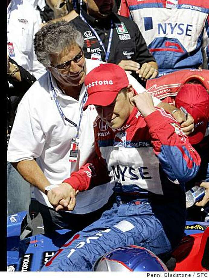 : Mario Andretti congratulates his grandson Marco Andretti in the winners circle after winning the Indy Car Grand Prix of Sonoma, IRL race at Infineon Raceway. Event on 8/27/06 in Sonoma.Penni Gladstone / The Chronicle***cq Cardinale Mario Andretti congratulates his grandson Marco Andretti in the winners circle after winning the Indy Car Grand Prix of Sonoma, IRL race at Infineon Raceway. Photo: Penni Gladstone, SFC