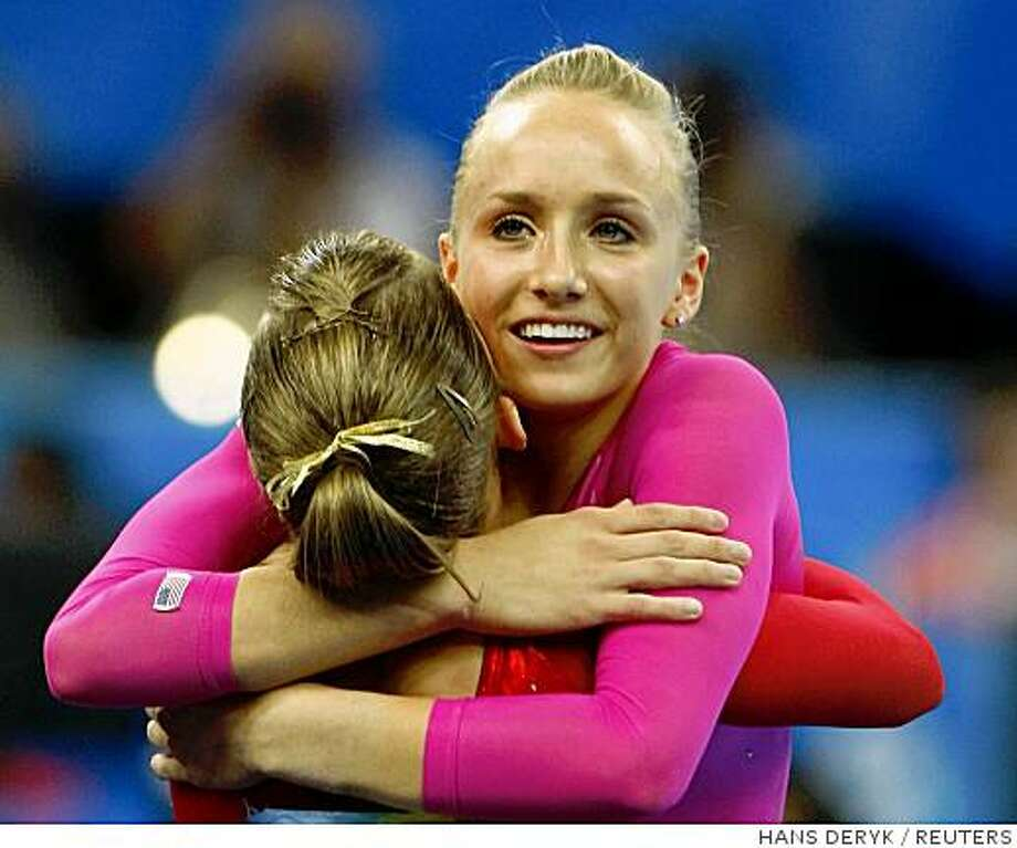 Nastia Liukin of the U.S. (R) is congratulated by teammate Shawn Johnson after winning the women's individual all-around artistic gymnastics final at the Beijing 2008 Olympic Games August 15, 2008.     REUTERS/Hans Deryk (CHINA) Photo: HANS DERYK, REUTERS