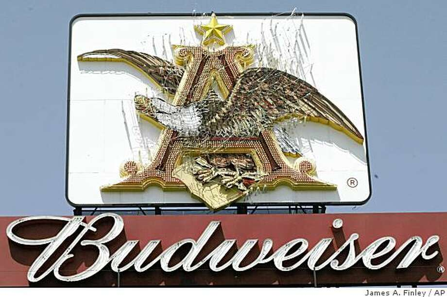 "** FILE** The Anheuser Busch sign with it's trademark eagle and ""A"" along I-64 in St. Louis  in this file photo from July 27, 2004. Anheuser-Bush renewed its sponsorship of the United States Olympic Committee last month through the 2012 London Olympics. (AP Photo/James A. Finley, File) Photo: James A. Finley, AP"
