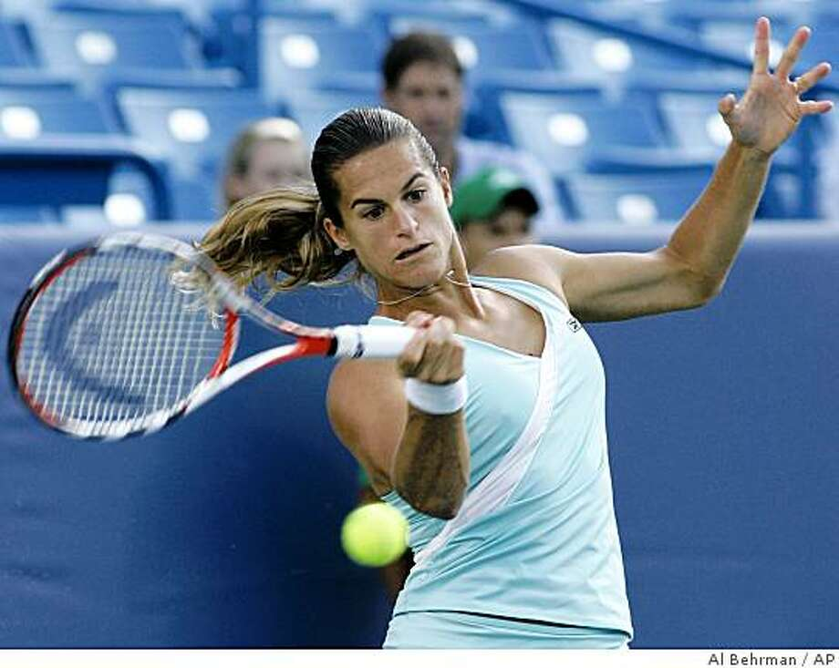 Amelie Mauresmo, of France, hits a forehand against Vania King in a quarterfinal match at the Western & Southern Financial Group Women's Open tennis tournament, Friday, Aug. 15, 2008, in Mason, Ohio. (AP Photo/Al Behrman) Photo: Al Behrman, AP
