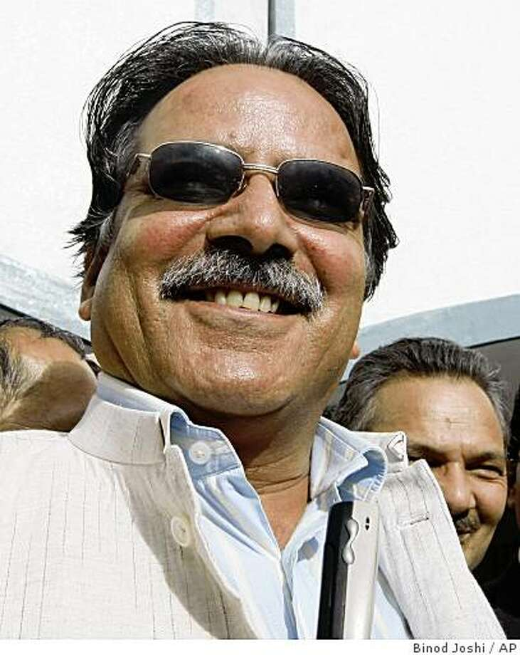 Nepal's Communist Party Maoist chairman Prachanda, gestures as he returns after filing his nomination papers in Katmandu, Nepal, Thursday, Aug. 14, 2008. The leader of Nepal's former communist rebels will face off against an ex-premier to become prime minister on Friday, officials said, in an election that could help end the country's political deadlock.(AP Photo/Binod Joshi) Photo: Binod Joshi, AP