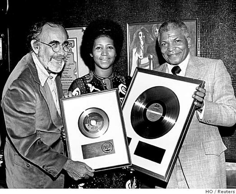 "Former music producer and Atlantic records executive Jerry Wexler (L) is shown with recording artist Aretha Franklin (C)  and Henry Allen in this 1971 publicity photo commemorating the gold record status of Franklin's ""Spanish Harlem"" recording, and released to Reuters August 15, 2008. Wexler, who helped build Atlantic Records into a music powerhouse in the 1950s and 1960s with artists like Franklin and Ray Charles, died in Florida on Friday at age 91, Atlantic Records said.     REUTERS/Popsie Randolph/Atlantic Records/Handout    (UNITED STATES) BLACK AND WHITE ONLY.  NO SALES. NO ARCHIVES. FOR EDITORIAL USE ONLY. NOT FOR SALE FOR MARKETING OR ADVERTISING CAMPAIGNS. Photo: HO, Reuters"