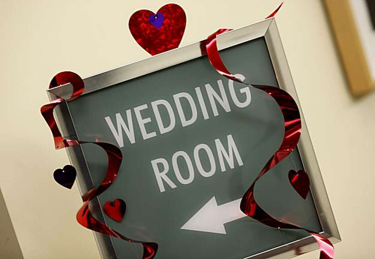 A sign on the second floor directs couples to the wedding room at the Alameda County clerk recorders offices in downtown Oakland on Valentines Day.