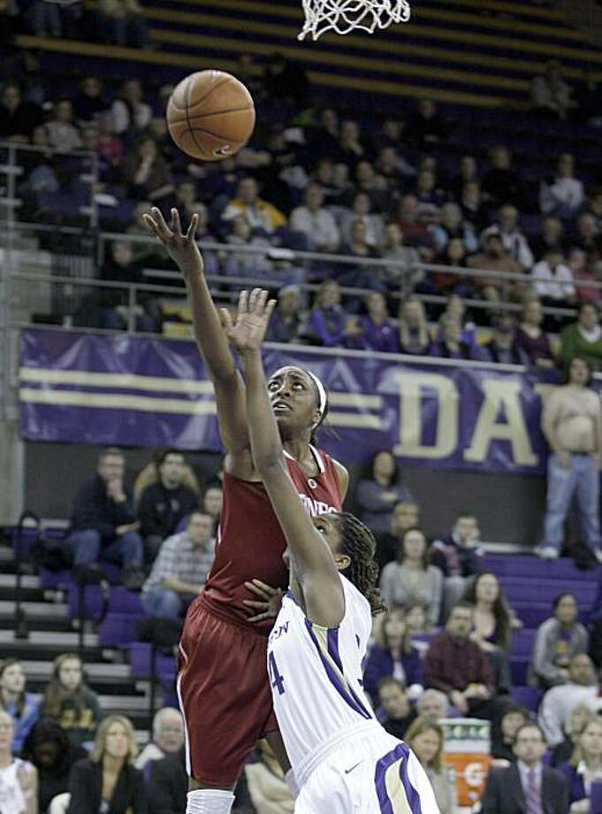 Stanford's Nnemkadi Ogwumike, left, puts up a shot over Washington's Mollie Williams, in the first half of a NCAA college basketball game, Friday, Feb. 12, 2010, in Seattle. Photo: Ted S. Warren, AP