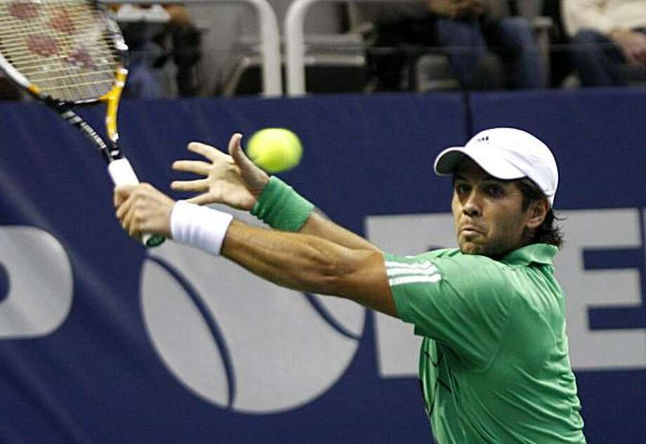 Fernando Verdasco, of Spain, hits a backhand against Andy Roddick, of the United States, during the finals of the SAP Open tennis tournament Sunday, Feb. 14, 2010, in San Jose, Calif. Photo: George Nikitin, AP