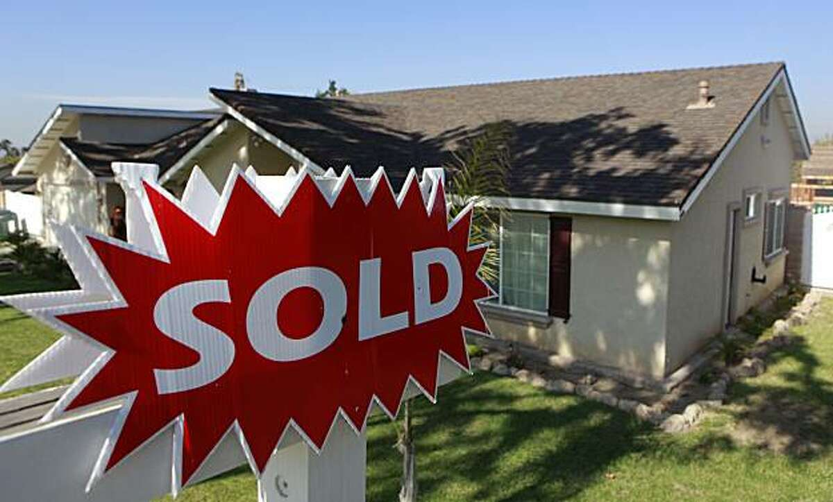 A 'sold' sign is seen outside a home in Corona, Calif in November 2009. Mortgage financier Freddie Mac said Thursday, Feb. 11th, rates on 30-year fixed mortgages slipped below 5 percent.
