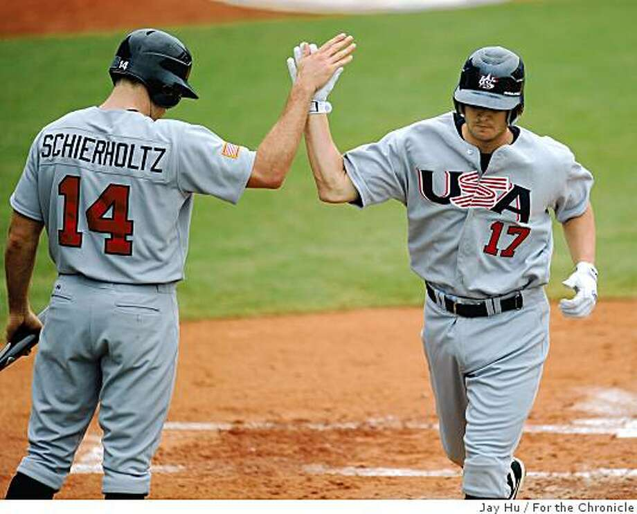 After hitting a solo homerun to give the USA a 1-0 lead over the Netherlands, Matt Brown is congratulated at home plate by Nate Schierholtz at the 2008 Summer Olympic Games, Thursday, Aug. 14, 2008, in Beijing. ( Jay Hu / For the Chronicle ) Photo: Jay Hu, For The Chronicle