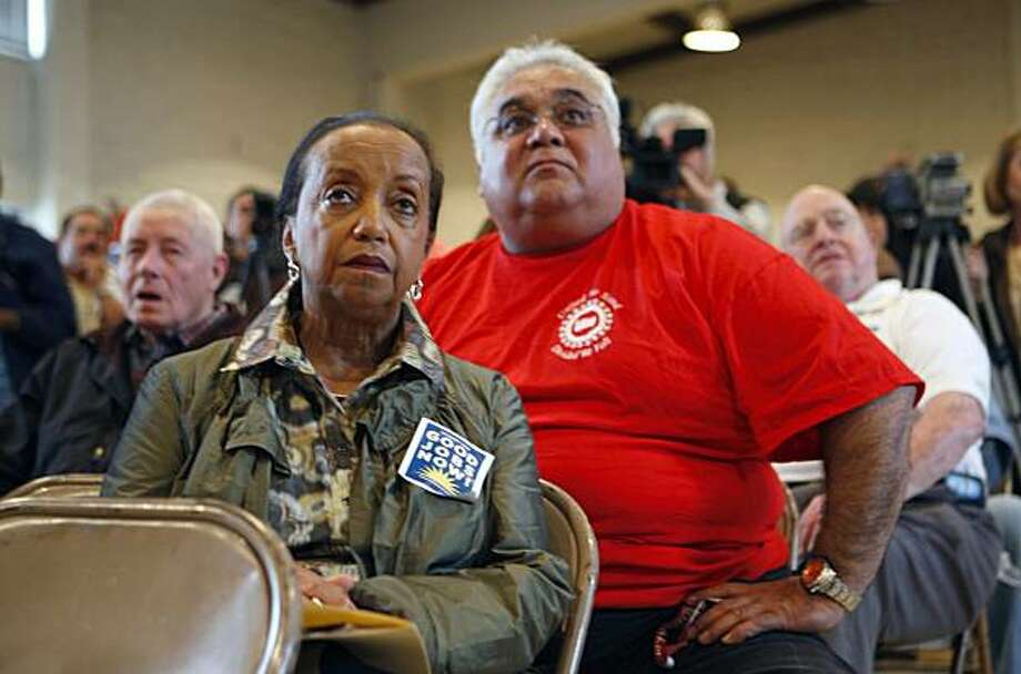 Jo Cazenave, staffer for Congressman Pete Stark, left, and Thomas Kanakani, a 25-year Nummi employee, right, listen at a United Auto Workers rally Friday at the UAW's Fremont headquarters. The UAW wants to persuade Toyota to keep operations in Fremont. Photo: Adam Lau, The Chronicle