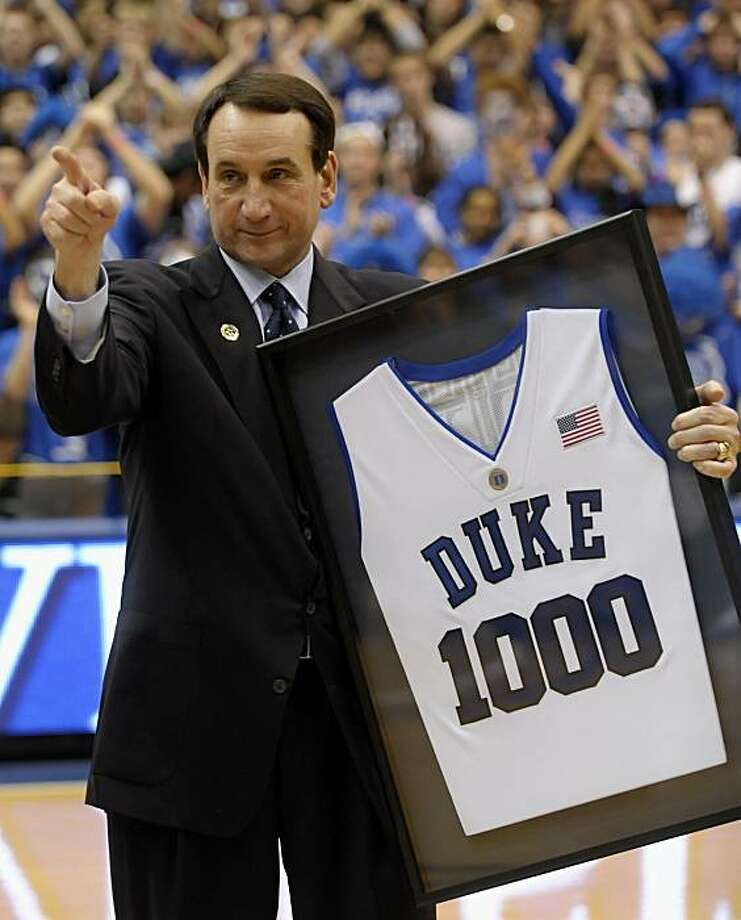 Duke head coach Mike Krzyzewski acknowledges former player J.J. Reddick after being awarded a jersey for coaching 1,000 Duke games after an NCAA college basketball game against Maryland in Durham, N.C., Saturday, Feb. 13, 2010. Krzyzewski, a Hall of Famernow in his 30th season in Durham, has won 781 of those 1,000 games, including three NCAA championships. Photo: Sara D. Davis, AP