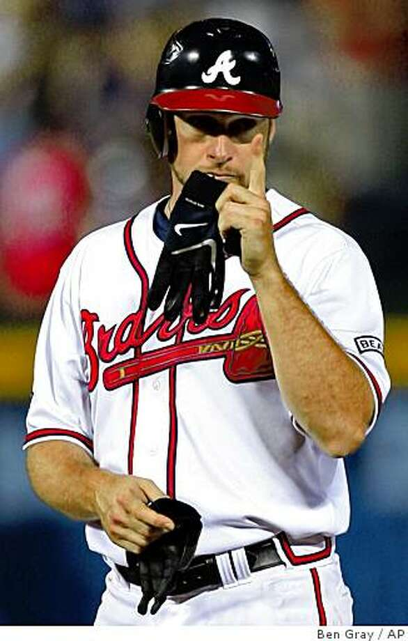 Atlanta Braves' Mark Kotsay signals to the Braves dugout after hitting a double in the seventh inning against the Chicago Cubs  to complete the batting cycle during a baseball game,  Thursday, Aug. 14, 2008, in Atlanta.  Kotsay went 5-for-5 and joined Albert Hall as the only Atlanta players to single, double, triple and homer in the same game. (AP Photo/Atlanta Journal-Constitution, Ben Gray)      GWINNETT DAILY POST OUT, MARIETTA DAILY JOURNAL OUT Photo: Ben Gray, AP