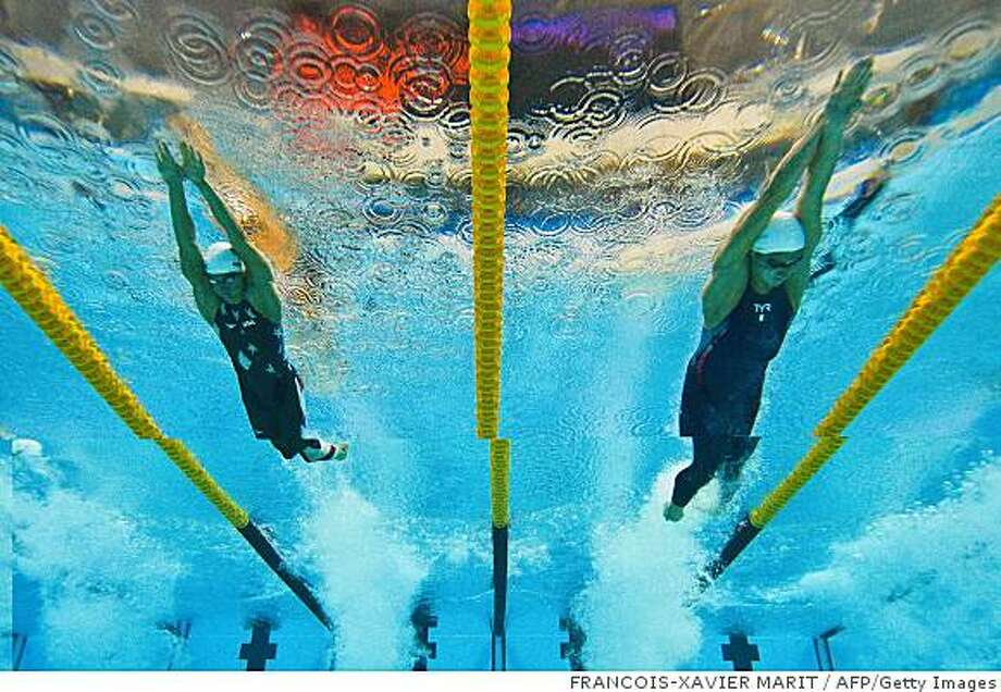 This underwater photograph shows France's Amaury Leveaux  (R) and US swimmer Ben Wildman-Tobriner competing during the men's 50m freestyle swimming heats at the National Aquatics Center during the 2008 Beijing Olympic Games in Beijing on August 14, 2008. AFP PHOTO / FRANCOIS-XAVIER MARIT  (Photo credit should read FRANCOIS-XAVIER MARIT/AFP/Getty Images) Photo: FRANCOIS-XAVIER MARIT, AFP/Getty Images