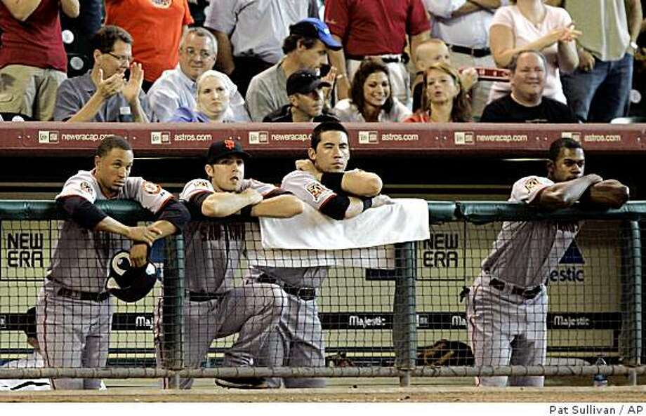 San Francisco Giants players watch the final outs of the game against the Houston Astros on Thursday, Aug. 14, 2008 in Houston. The Astros won 7-4 to sweep the Giants in the four game series. Photo: Pat Sullivan, AP