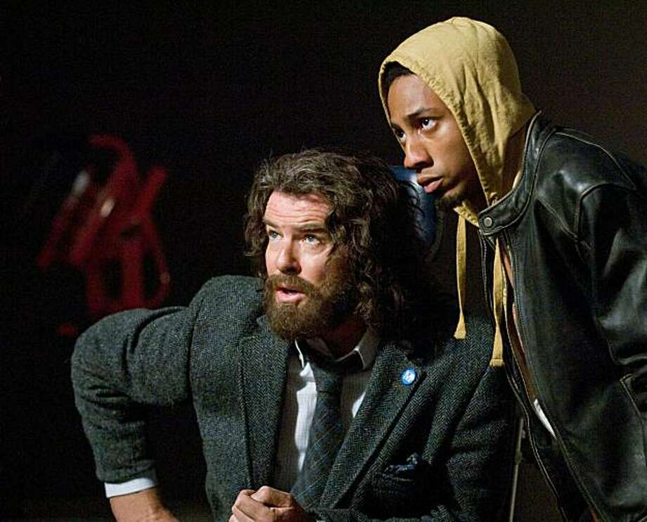 During whatÕs supposed to be a harmless field trip, Mr. Brunner (Pierce Brosnan, left) and Grover (Brandon T. Jackson) react to an unexpected threat. Photo credit: Doane Gregory Photo: Doane Gregory, Twentieth Century Fox