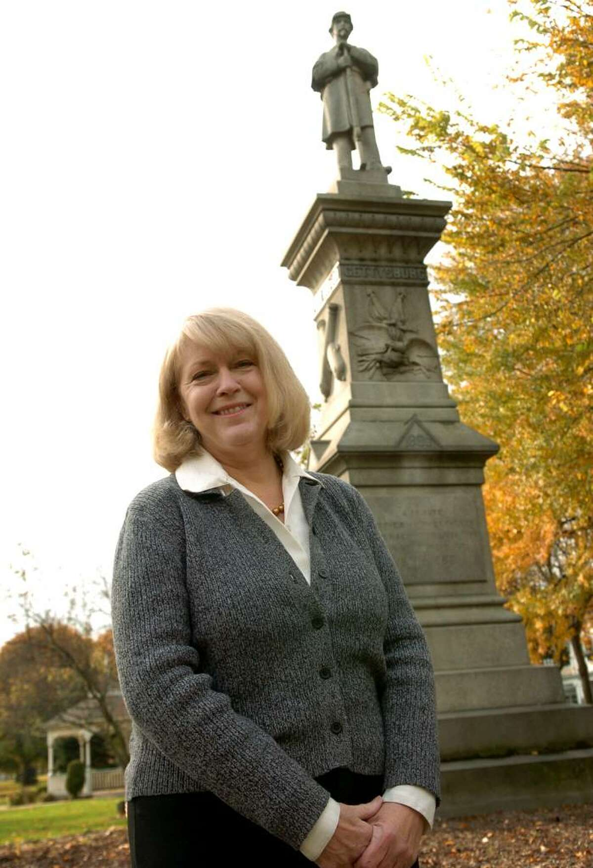 Sharon B. Smith of Milford, who recently published a book chronicling Connecticut's role in the Civil War, by the Civil War monument on the green in Milford.