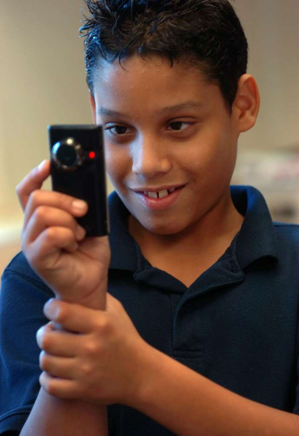 Through a collaboration with the Fairfield Community Theater, a group of Bridgeport kids take part each week in a film school at the Burroughs Community Center. Here, Jovanni Soto, 12, films the