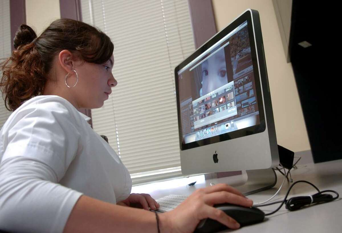 Through a collaboration with the Fairfield Community Theater, a group of Bridgeport kids take part each week in a film school at the Burroughs Community Center. Here, Jannette Latorre, 13, edits one of her movies on the computer, while at the center in Bridgeport, Conn. on Thursday Oct. 29, 2009.