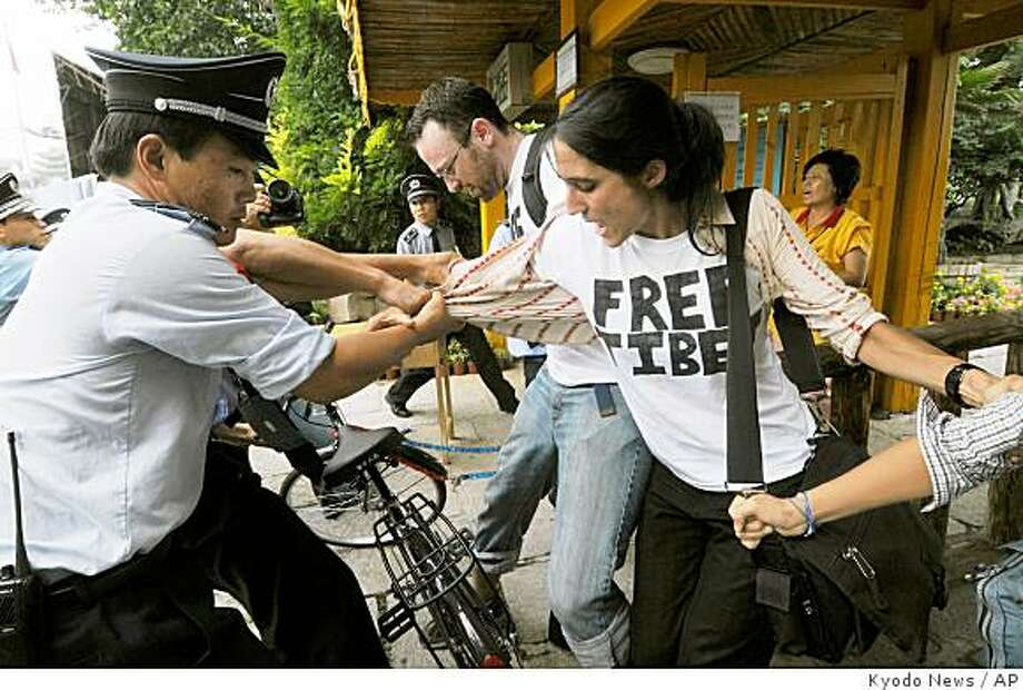 Foreign pro-Tibet activists are detained by Chinese police and security guards after they staged a protest near the main Olympics venue in Beijing Wednesday, Aug. 13, 2008. Eight activists and a British television journalist who tried to film them were detained by police, a rights group and a TV producer said. (AP Photo/Kyodo News) ** JAPAN OUT, MANDATORY CREDIT, FOR COMMERCIAL USE ONLY IN NORTH AMERICA ** Photo: Kyodo News, AP