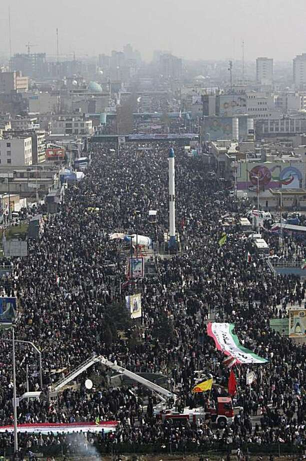 In this photo released by the semi-official Iranian Fars News Agency, pro-government demonstrators walk toward Azadi (freedom) Square in Tehran, Iran, Thursday, Feb. 11, 2010, in a rally commemorating 31st anniversary of the 1979 Islamic Revolution that toppled the US-backed late Shah Mohammad Reza Pahlavi. (AP Photo/Fars News Agency, Hossein Zohrevand) EDITORS NOTE AS A RESULT OF AN OFFICIAL IRANIAN GOVERNMENT BAN ON FOREIGN MEDIA COVERING SOME EVENTS IN IRAN, THE AP WAS PREVENTED FROM INDEPENDENT ACCESS TO THIS EVENT. Photo: Hossein Zohrevand, AP