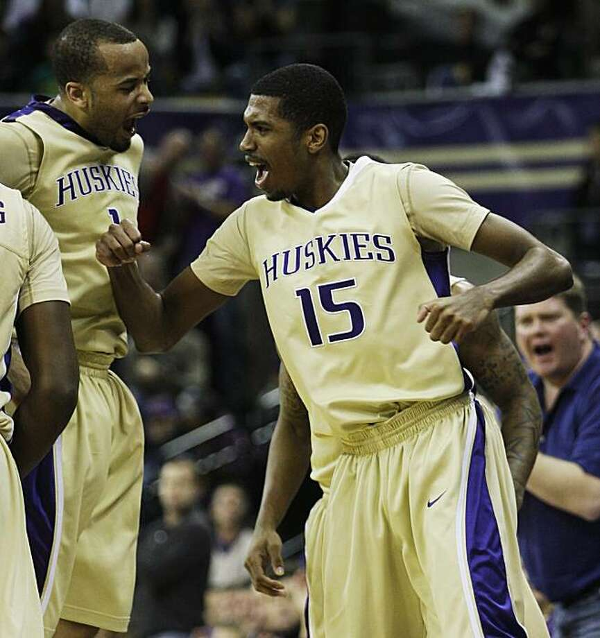 Washington's Scott Suggs, right, and Venoy Overton, left, celebrate a play against Arizona State in the first half of a NCAA college basketball game, Saturday, Feb. 6, 2010, in Seattle. Photo: Ted S. Warren, AP