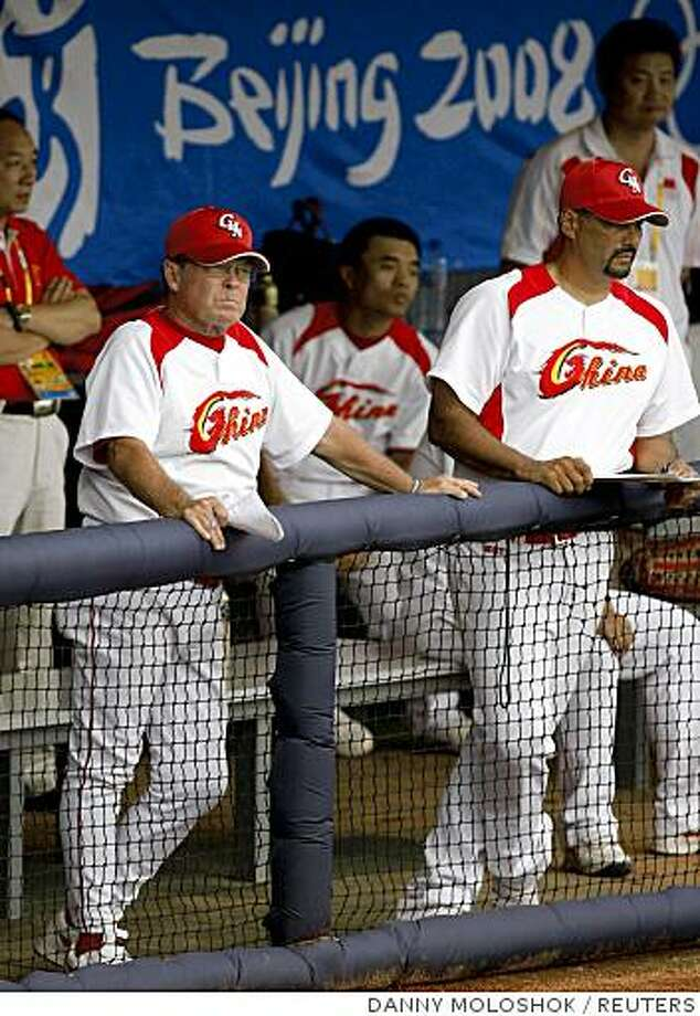China's manager Jim Lefebvre (L) watches their exhibition baseball game against the U.S. at the Wukesong Sports Center Baseball Field during the Beijing 2008 Olympic Games August 11, 2008.     REUTERS/Danny Moloshok (CHINA) Photo: DANNY MOLOSHOK, REUTERS
