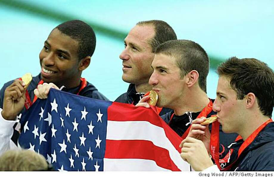 (From L) US swimmers Cullen Jones, Jason Lezak, Michael Phelps and Garrett Weber-Gale pose with their medals after the men's 4X100m freestyle relay swimming medal ceremony at the National Aquatics Center in the 2008 Beijing Olympic Games on August 11, 2008. The United States stunned France in an epic men's 4x100m freestyle relay final Monday to keep Michael Phelps's dream of eight gold medals at the Beijing Olympics alive. AFP PHOTO / GREG WOOD (Photo credit should read GREG WOOD/AFP/Getty Images) Photo: Greg Wood, AFP/Getty Images