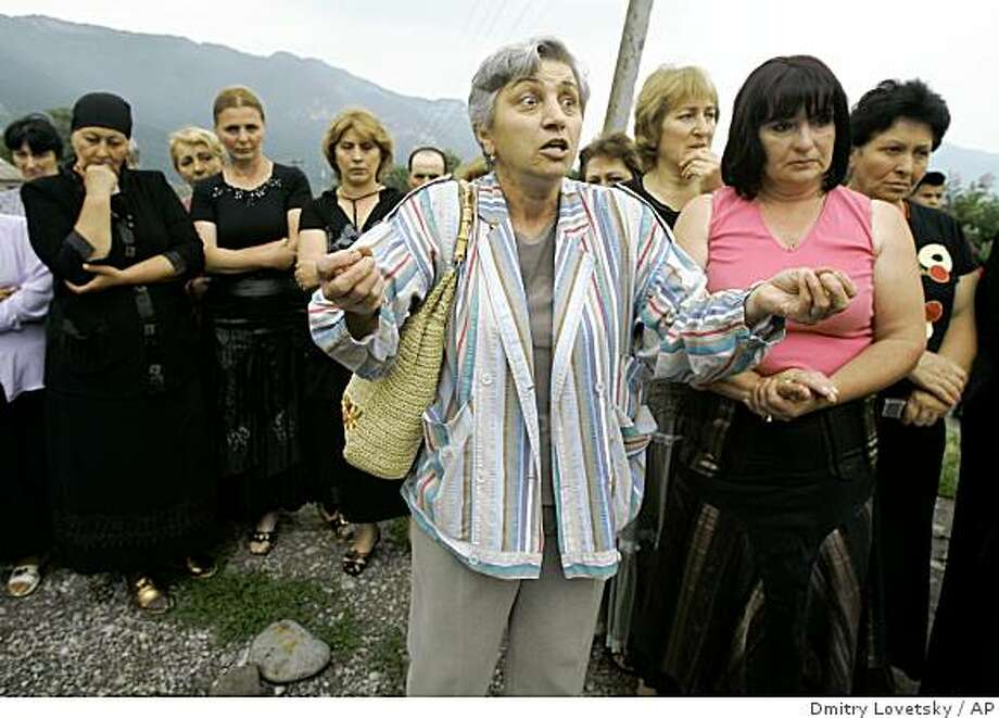 Ludmila Bigayeva-Kinkadze, an ethnic Ossetian woman married to a Georgian man, condemns the Russian-Georgian conflict at a rally near Vladikavkaz, the main city of North Ossetia,  Russia, Tuesday, Aug. 12, 2008. The rally was a response to threats received by ethnic Georgians in the ethnically mixed village of Verkhnyaya Balta outside Vladikavkaz. (AP Photo/Dmitry Lovetsky) Photo: Dmitry Lovetsky, AP