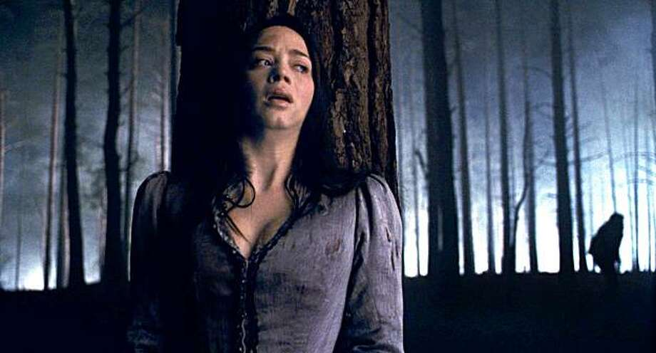 Gwen Conliffe (EMILY BLUNT) hides from an unimaginable creature in the action-horror inspired by the classic Universal film that launched a legacy of horror, ?The Wolfman?. Photo: Universal Pictures