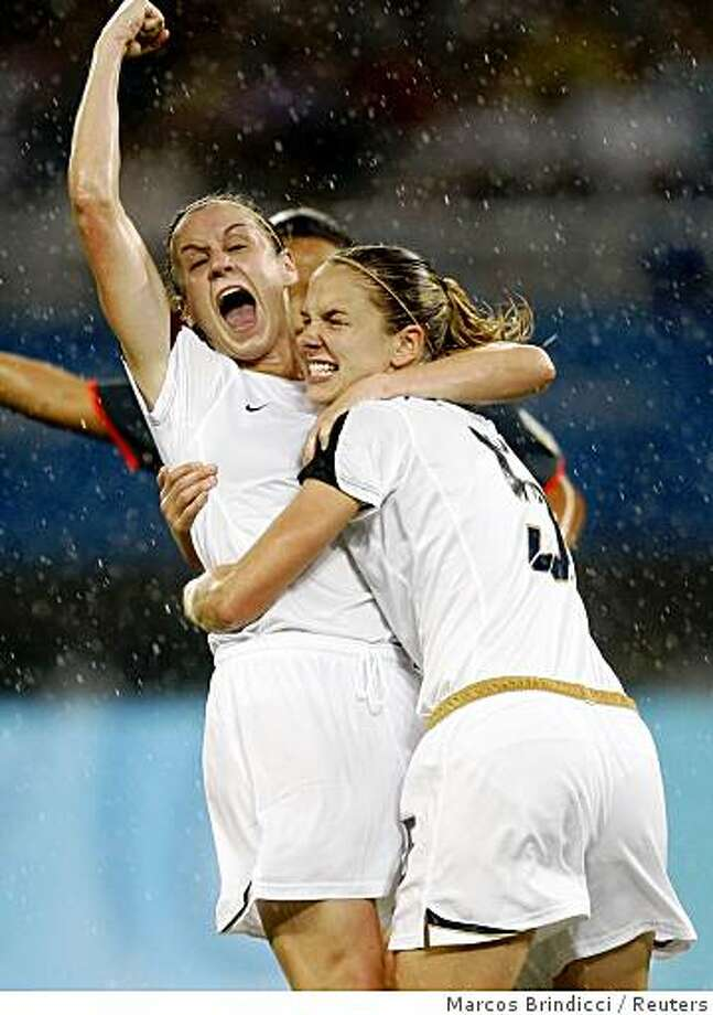 Heather O'Reilly and  Lindsay Tarpley (R) of the U.S. celebrate after teammate Angela Hucles scored against Canada during their women's quarter final soccer match in Shanghai Stadium at the Beijing 2008 Olympic Games August 15, 2008. Photo: Marcos Brindicci, Reuters