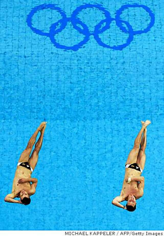 Germany's Patrick Hausding and Sascha Klein compete during the men's synchronised 10m platform at the National Aquatics Center in the 2008 Beijing Olympic Games on August 11, 2008.  China's Lin Yue and Huo Liang won the Olympic men's synchronised 10m platform dive gold medal ahead of Germany's Patrick Hausding and Sascha Klein and Russia's Gleb Galperin and Dmitriy Dobroskok   AFP PHOTO / DDP / MICHAEL KAPPELER  (Photo credit should read MICHAEL KAPPELER/AFP/Getty Images) Photo: MICHAEL KAPPELER, AFP/Getty Images