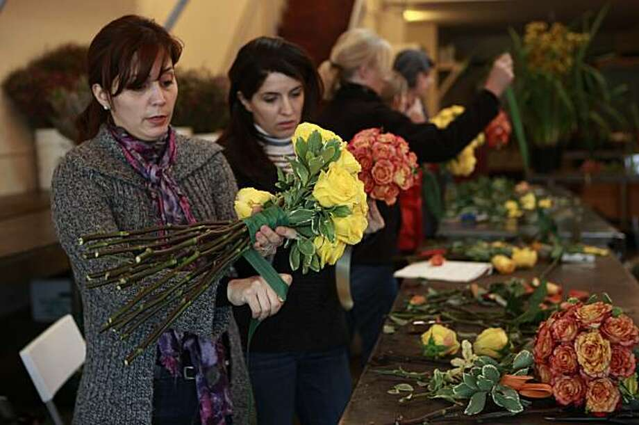 Nogol Adelmanesh (left) and Fatemeh Keramat (second from left), both of San Jose,  assemble bridal bouquets for their class project during class at the San Francisco School of Flower Design in San Francisco, Calif. on Wednesday January 6, 2010. Photo: Lea Suzuki, The Chronicle