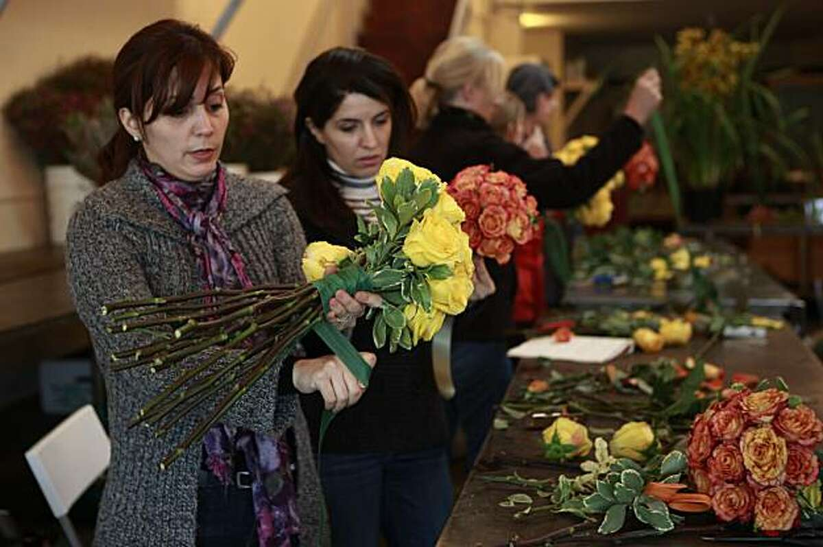 Nogol Adelmanesh (left) and Fatemeh Keramat (second from left), both of San Jose, assemble bridal bouquets for their class project during class at the San Francisco School of Flower Design in San Francisco, Calif. on Wednesday January 6, 2010.