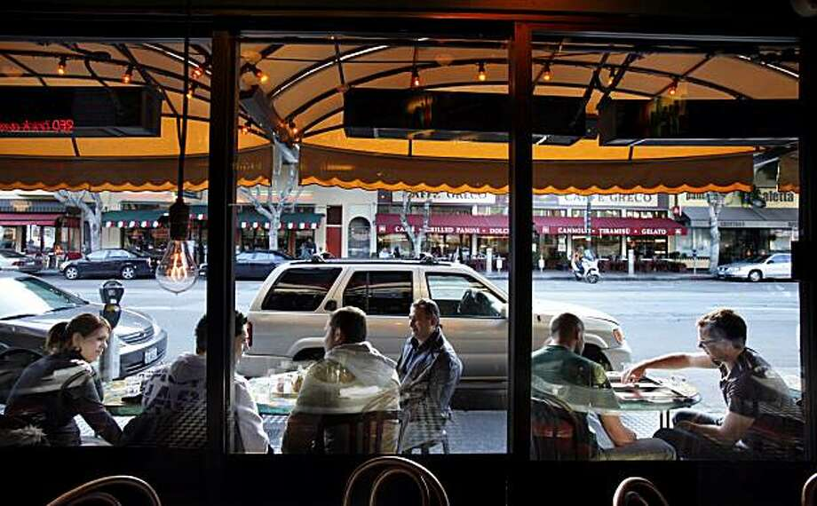 Outdoor diners at Calzone's enjoyed good views of Columbus Avenue late in the afternoon.  Parking spaces in San Francisco's, Calif. North Beach neighborhood would be replaced by outdoor cafe seating in a new initiative Tuesday February 9, 2010. Photo: Brant Ward, The Chronicle