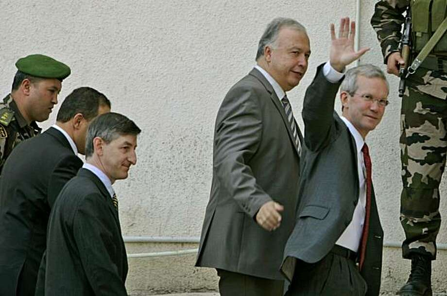 FILE - In this file photo taken Saturday, Nov. 3, 2007, then U.S. Assistant Secretary of State David Welch, right, waves as he walks with Abbas aide Rafiq Husseini, second right, upon his arrival for meeting with Palestinian President Mahmoud Abbas,  at his headquarters in the West Bank city of Ramallah. Palestinian officials are rallying around Husseini, a top aide to Palestinian President Mahmoud Abbas, after a video showing him in the nude in a compromising situation was broadcast on Israeli TV. However, a prominent Palestinian journalist urged Husseini to resign and Abbas' Fatah movement promised to look into possible impropriety. Photo: Muhammed Muheisen, File, AP