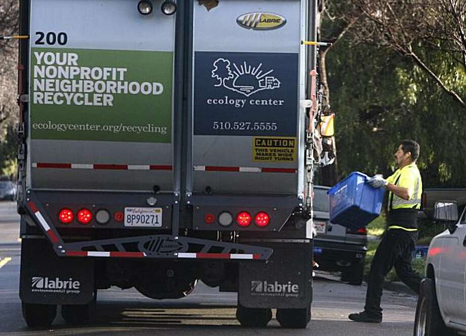 A truck collects curbside recyclables in Berkeley, Calif. on Friday, Feb. 5, 2010. Residents in the eco-conscious city are recycling more and more so are using smaller trash bins. The result is a $4 million deficit in Berkeley's sanitation budget. Photo: Paul Chinn, The Chronicle