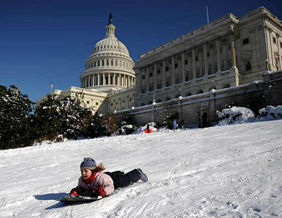 Children sled down Capitol Hill in Washington, DC on February 8, 2010 as the District of Columbia and the mid-Atlantic region recover from a weekend blizzard that droped more than two feet of snow (about 75 cm) on the capital. The Federal Government closed today along with schools and many businesses. Photo: Tim Sloan, AFP/Getty Images