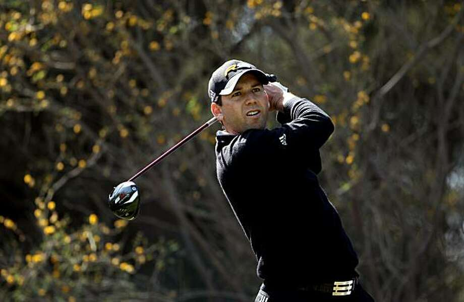 DOHA, QATAR - JANUARY 27:  Sergio Garcia of Spain tees off on the 12th hole during the Pro Am prior to the start of the Commercialbank Qatar Masters at Doha Golf Club on January 27, 2010 in Doha, Qatar. Photo: Andrew Redington, Getty Images