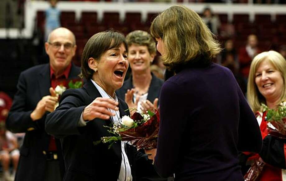 Stanford head coach Tara VanDerveer  gives Chris MacMurdo, one of members of the 1989-90 NCAA Championship team a hug,  Sunday Feb.7, 2010, in Stanford, Calif. The ceremony followed the 2010 Stanford team defeating the USC Women of Troy 77-39. Photo: Lacy Atkins, The Chronicle