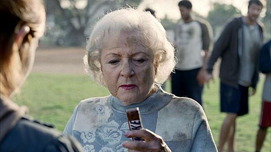 This image provided by Snickers shows part of a television ad featuring actress Betty White scheduled to air during the 2010 Super Bowl. (AP Photo/Snickers) NO SALES Photo: Snickers, AP