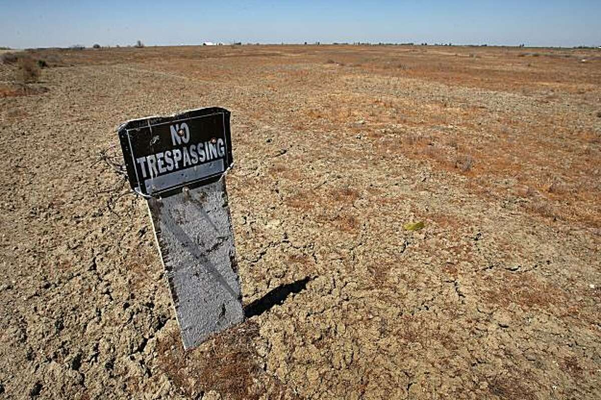 TRANQUILLITY, CA - APRIL 19: A no trespassing sign stands over cracked ground in an unplanted field on April 19, 2009 near Tranquility, California. Central Valley farmers and farm workers are suffering through the third year of the worsening California drought with extreme water shortages and job losses. The office of California Gov. Arnold Schwarzenegger has predicted Central Valley farm losses to reach between $325 million and $477 million with a total loss for crop production and related business between $440 and $644 million. Central Valley is expected to lose 16,200 to 23,700 full-time jobs and food prices are expected to rise nationwide. Interior Secretary Ken Salazar this week pledged $260 million in federal stimulus money to help address the California water crisis. (Photo by David McNew/Getty Images)