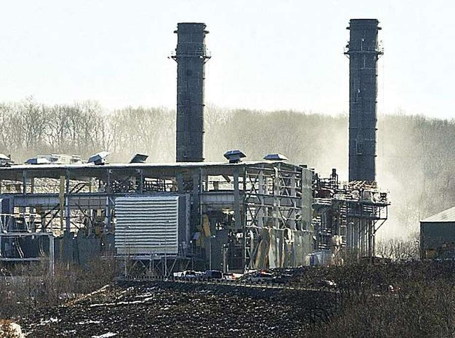 ** ALTERNATIVE CROP OF CTMID101 ** Smoke comes from the the Kleen Energy plant on River Road in Middletown, Conn., Sunday Feb. 7, 2010, as emergency vehicles make their way to the scene of an explosion there. Multiple people have died in an explosion at a power plant in Connecticut and an unknown number of people are injured. (AP Photo/The Middletown Press, Catherine Avalone) MANDATORY CREDIT Photo: Catherine Avalone, AP