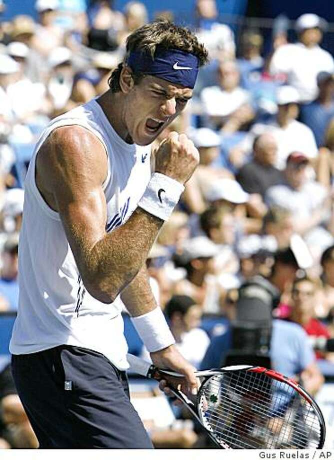 Juan Martin del Potro, of Argentina, celebrates holding his serve in the second set during his match with Andy Roddick in the finals of Countrywide Classic tennis tournament, Sunday, Aug. 10, 2008, in Los Angeles. Del Potro won 6-1, 7-6(2).  (AP Photo/Gus Ruelas) Photo: Gus Ruelas, AP