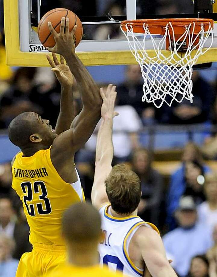 California guard Patrick Christopher gets by UCLA guard Michael Roll, bottom right, for a basket during the second half Saturday in Los Angeles. Photo: Gus Ruelas, AP