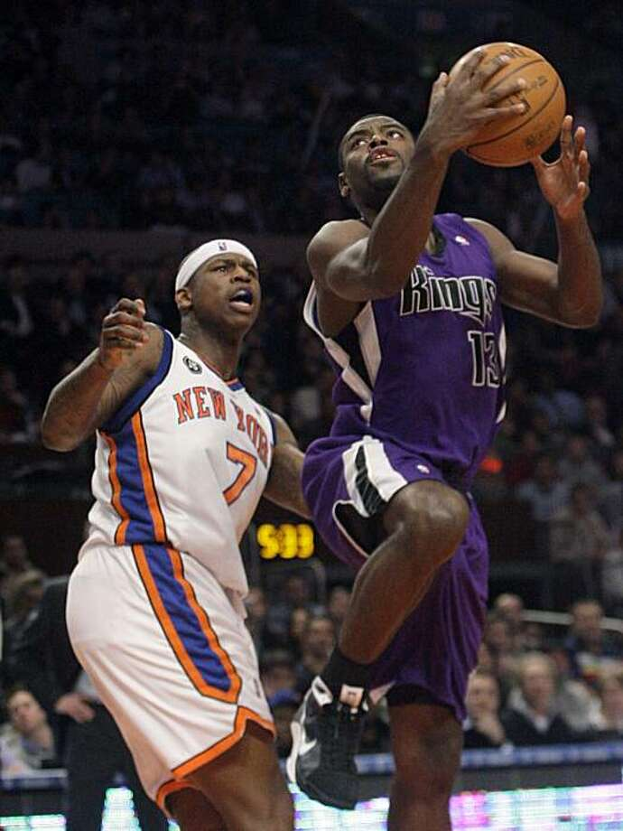 Sacramento Kings' Tyreke Evans (13) drives past New York Knicks' Al Harrington (7) during the second half of an NBA basketball game Tuesday, Feb. 9, 2010  in New York. Evans scored 27 points as the Kings won the game 118-114. Photo: Frank Franklin II, AP
