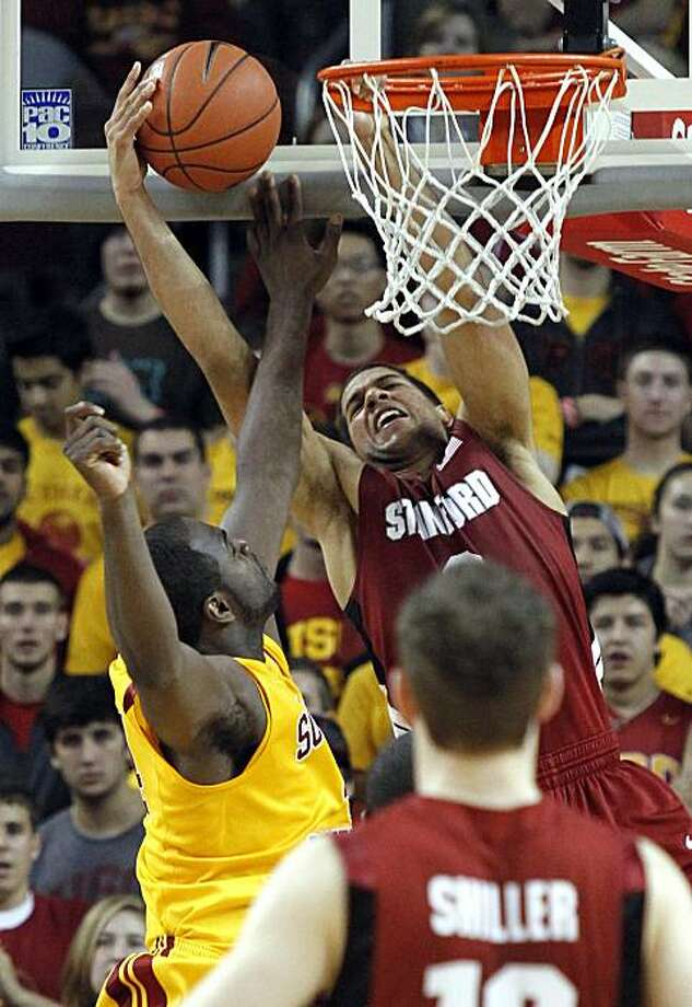 Stanford's Landry Fields, right, has his dunk blocked in the final minutes by Southern California's Leonard Washington, left,  in the second half of an NCAA college basketball game Los Angeles, Saturday, Feb. 6, 2010. Southern California won 54-49. Photo: Lori Shepler, AP