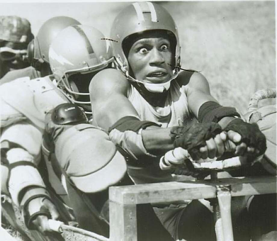 """10-19-2010_1719_olympiccmovies07.jpg  1993  Caption: Derice Bannock in """"Cool Runnings,"""" a movie about inexperienced Jamaicans entering the bobsled competition in the Olympics. Photo: Walt Disney Pictures, The Chronicle, File"""