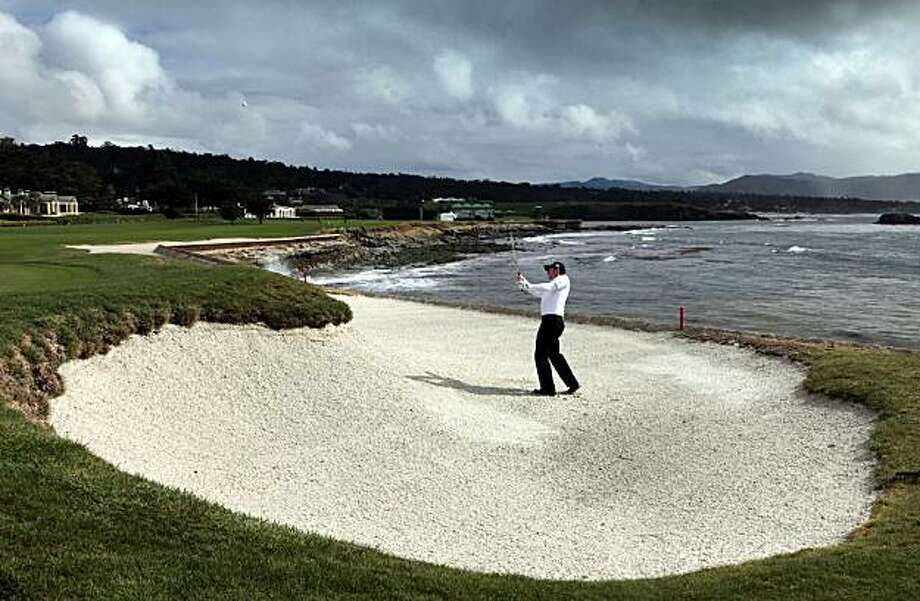 Garth Mulroy blast out of the trap on the 18th green at Pebble Beach Tuesday Feb. 9, 2010. Practice rounds for both Pro and amateurs started on all three courses used to play the AT&T Pebble Beach National Pro-Am golf tournament Tuesday. Photo: Lance Iversen, The Chronicle